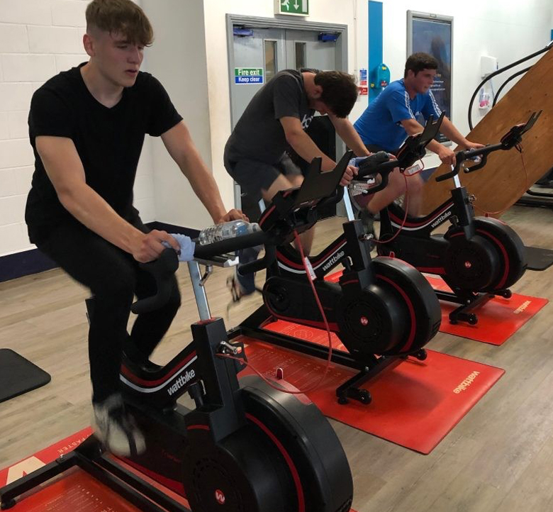 riders training in the gym sq