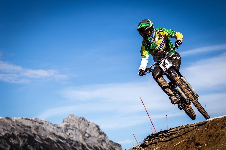Douglas Vieira, a mountain bike coaching client, riding his bike.