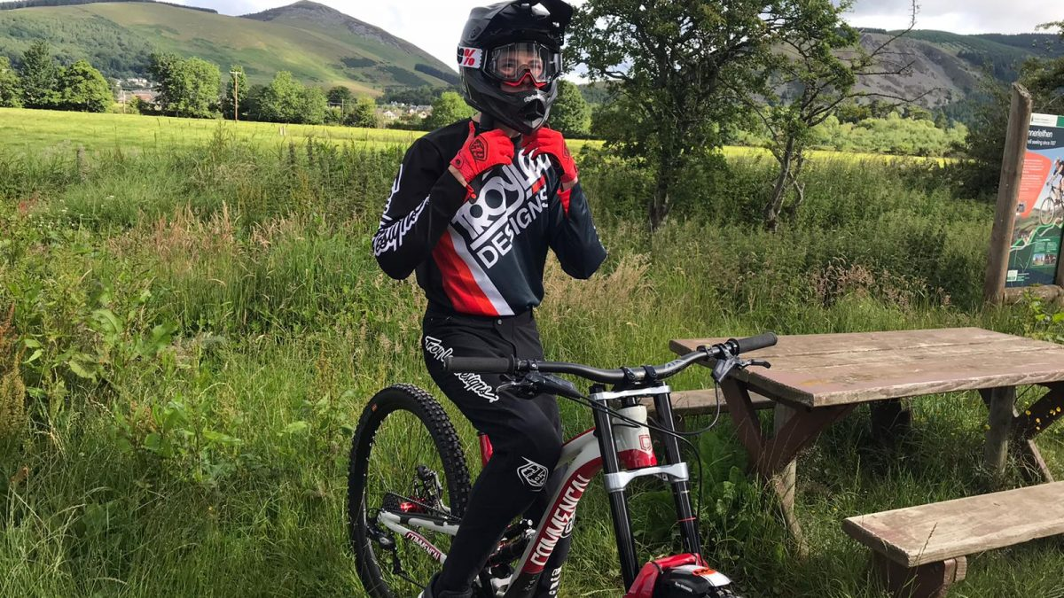 Ryan Branner, a mountain bike coaching client, riding his bike.